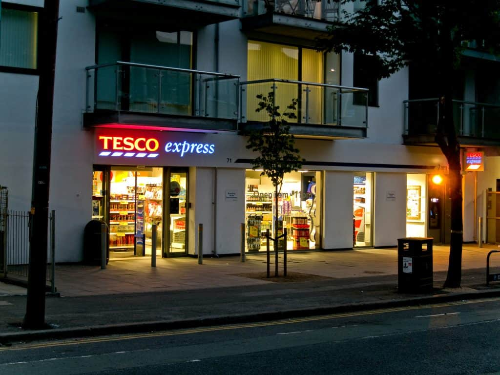 A Tesco Express at night in London