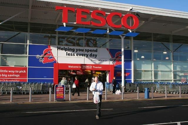 A Tesco store in the UK with people walking in and out