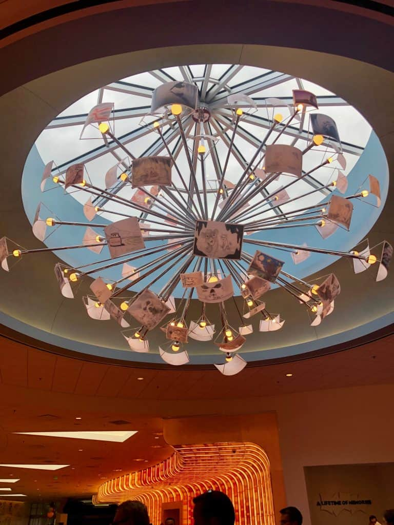 Art of Animation review ceiling light with drawn animation slides as a chandelier