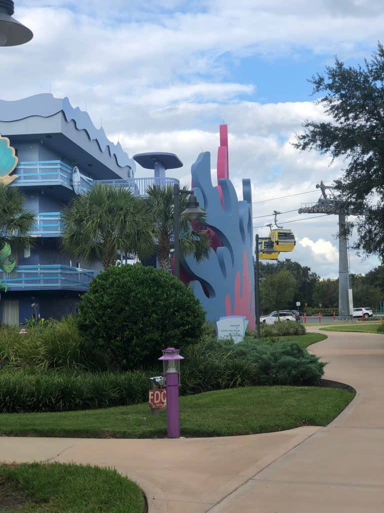 Theming at Disney's Art of Animation Resort with two Skyliner cars in the background