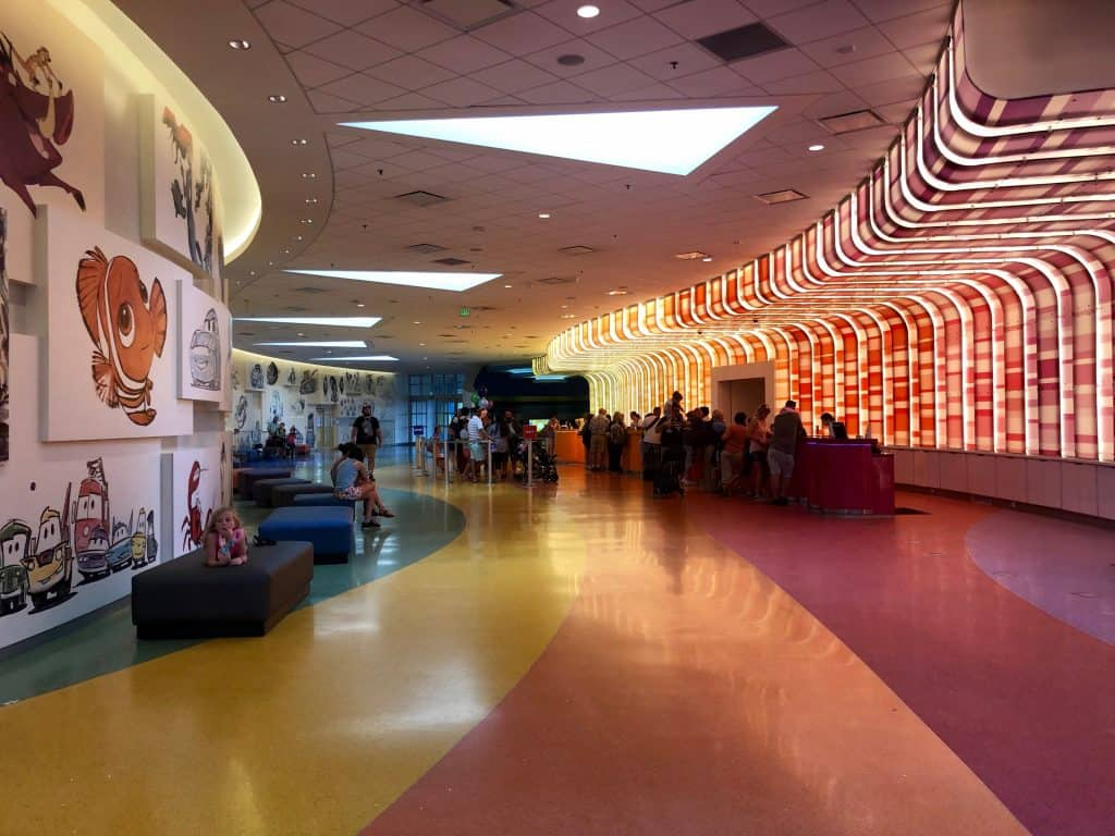 Inside the Disney Art of Animation lobby, with animation artwork on the walls