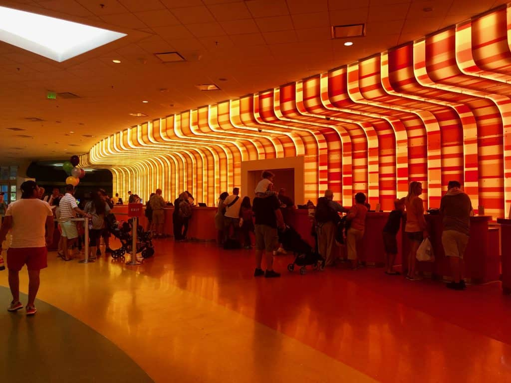 Inside the Disney Art of Animation lobby, with red lights