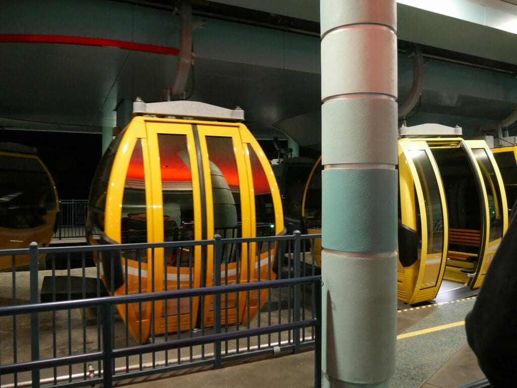 Two Disney Skyliner cars inside a station