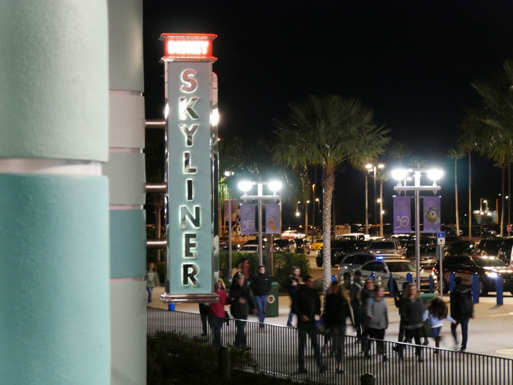 Disney Skyliner sign at night lit up