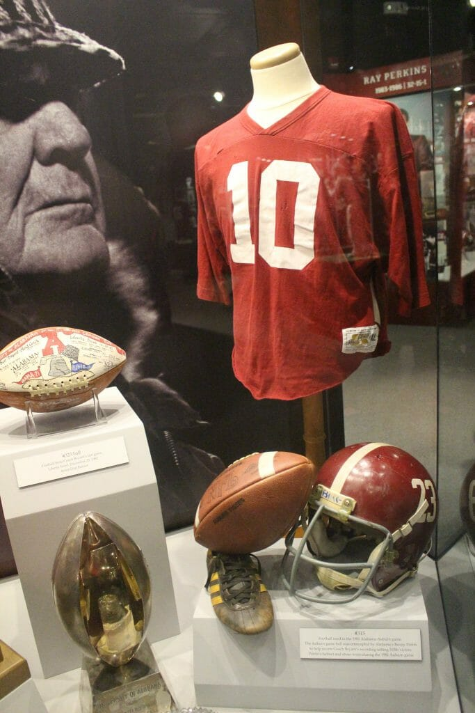 Football items in a display cabinet at the Bear Bryant museum in Tuscaloosa