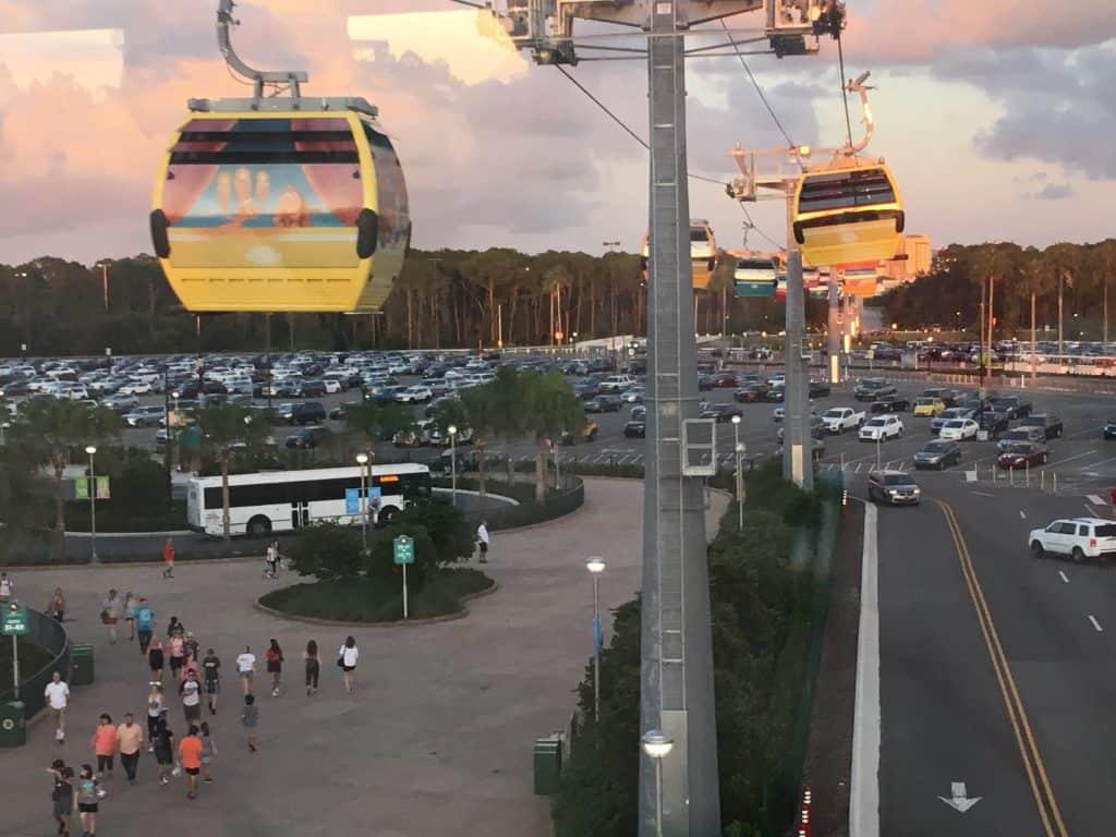 Disney World Skyliner cars above a parking lot