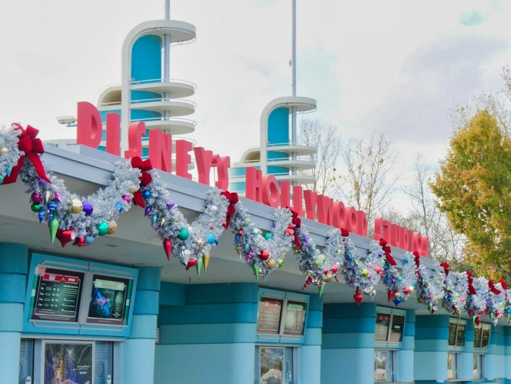 Hollywood Studios entrance decorated for Christmas with tinsel
