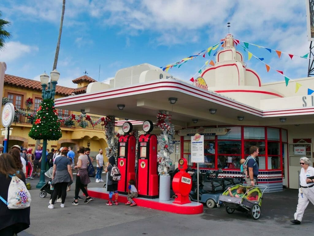 A gas station decorated for Christmas at Hollywood Studios at Christmas