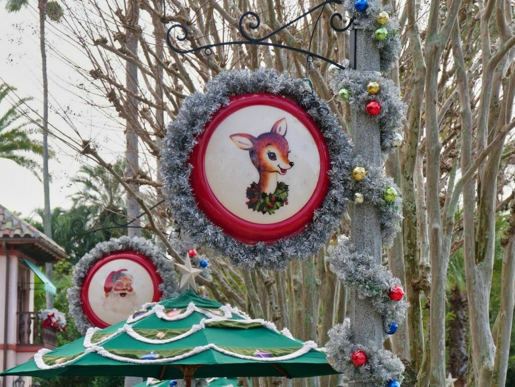 A decorative Christmas sign with Bambi in it covered in silver tinsel