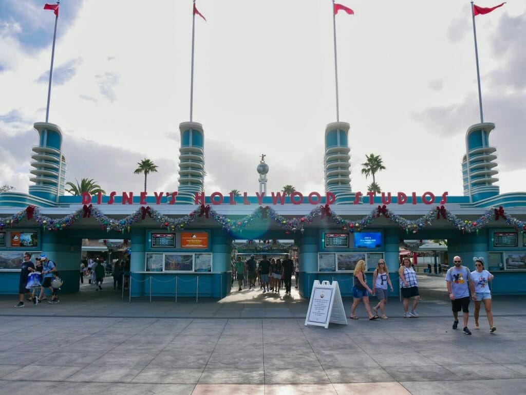 Hollywood Studios entrance with Christmas decorations on it