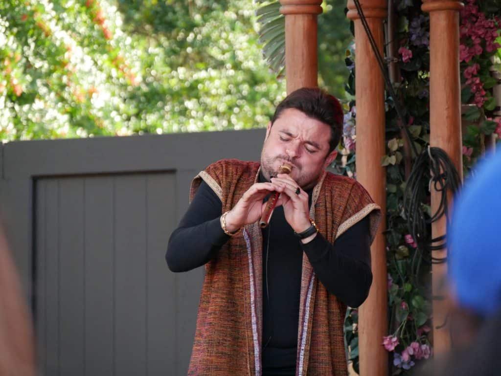 Man playing Moroccan instrument at Epcot, Disney World at Christmas