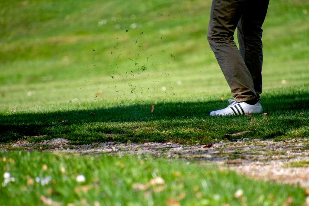 A golfer on grass