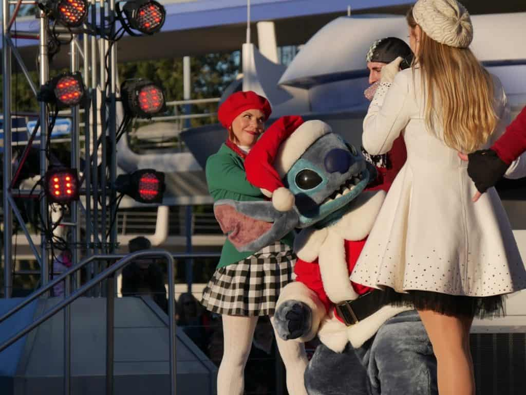 Stitch in a Santa Claus outfit at the Magic Kingdom in Disney World at Christmas