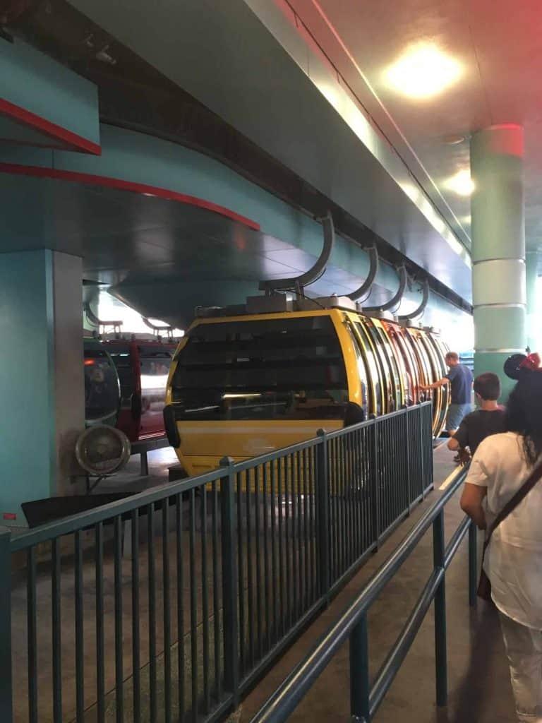 Disney Skyliner cars at a station