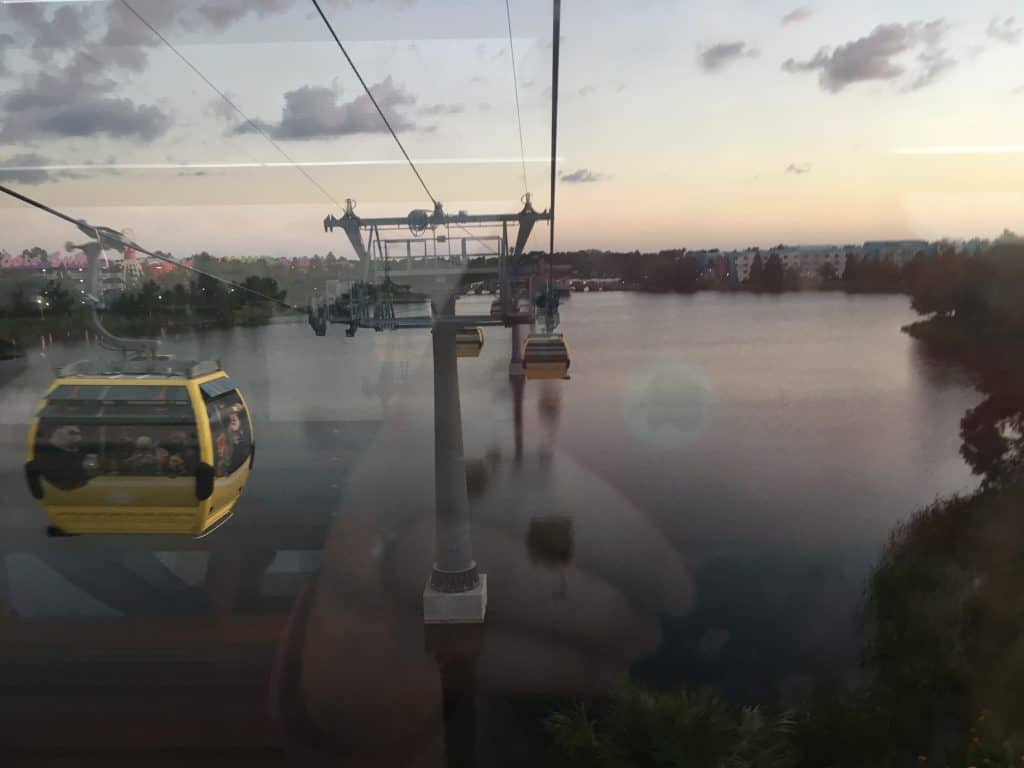The view from inside a Disney Skyliner car over a lake