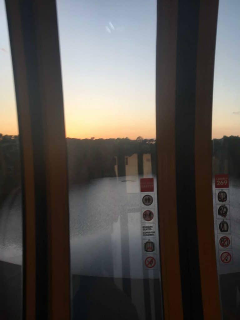 Inside a Disney Skyliner car at sunset
