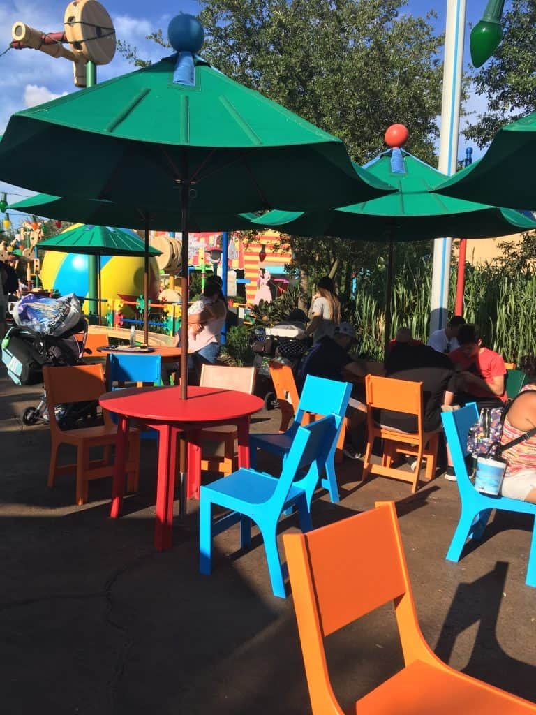 Seating at Woody's Lunchbox with bright colored tables and chairs