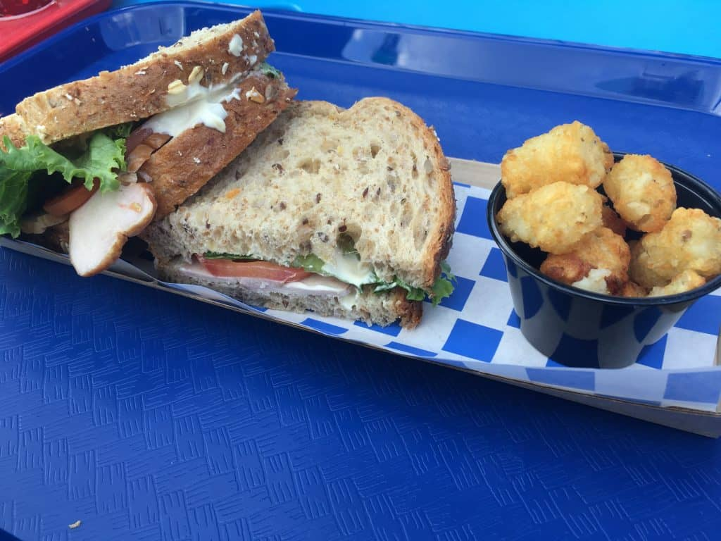 A turkey sandwich from Woody's Lunchbox with tater tots