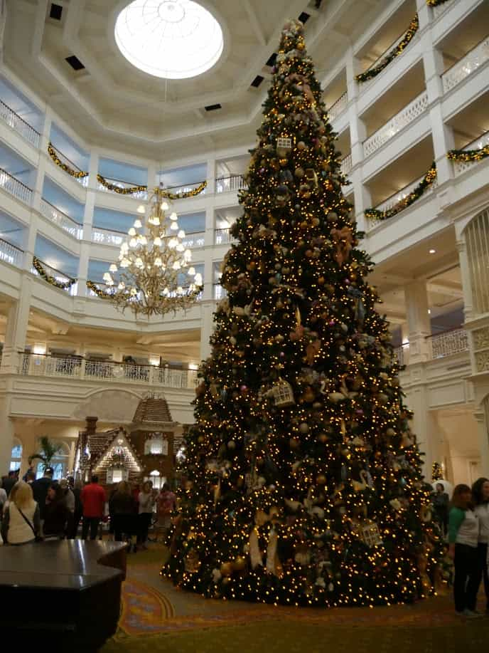 A large Christmas tree in the middle of the hotel at the Grand Floridian Disney World resort at Christmas