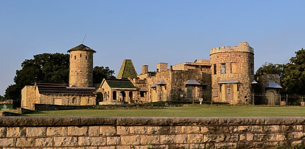 A dilapidated castle with a sunset glow on it, in Texas