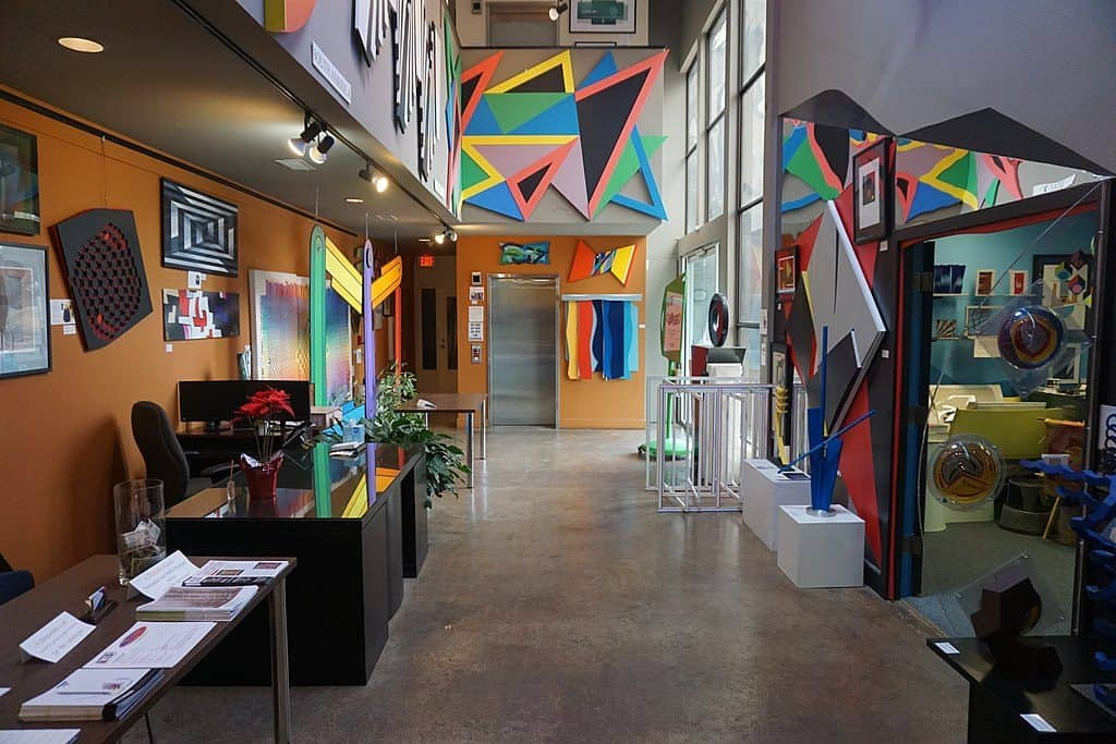 Inside a room at the Museum of Geometric and MADI Art, Dallas, with colourful art piece son the walls