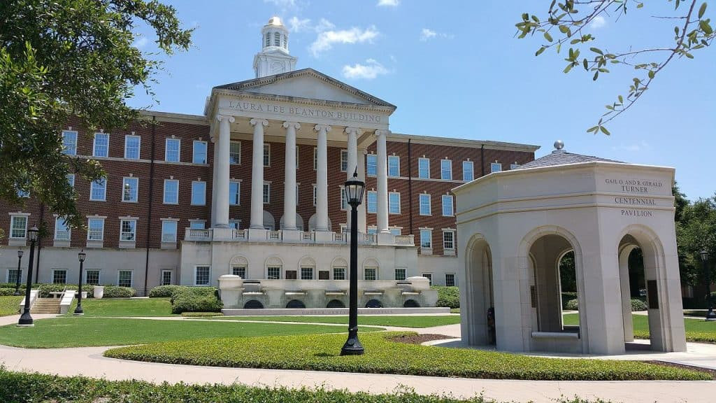 An old, grand, red brick and white stone building at Southern Methodist University, Texas