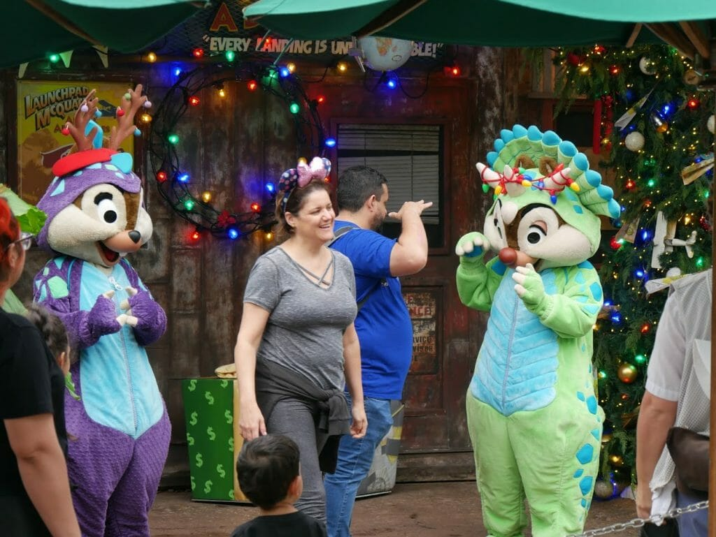Chip and Dale with antlers on greeting a guest