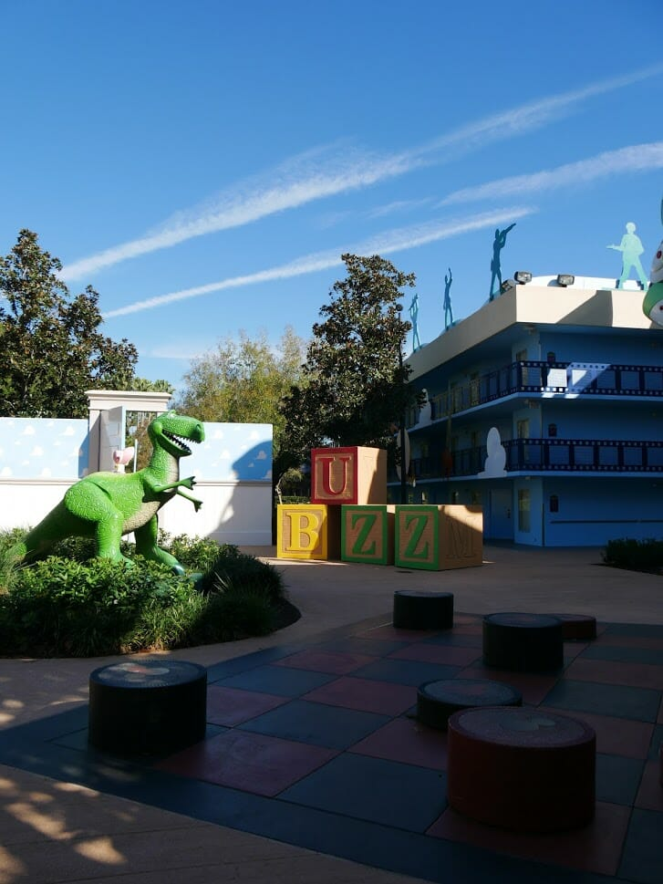 Disney All Star Movies resort Toy Story area with Rex and some play items in front