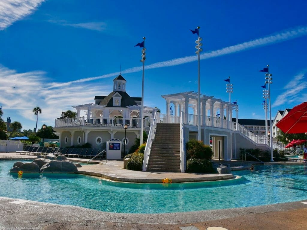 Beach Club swimming pool with a white pool building