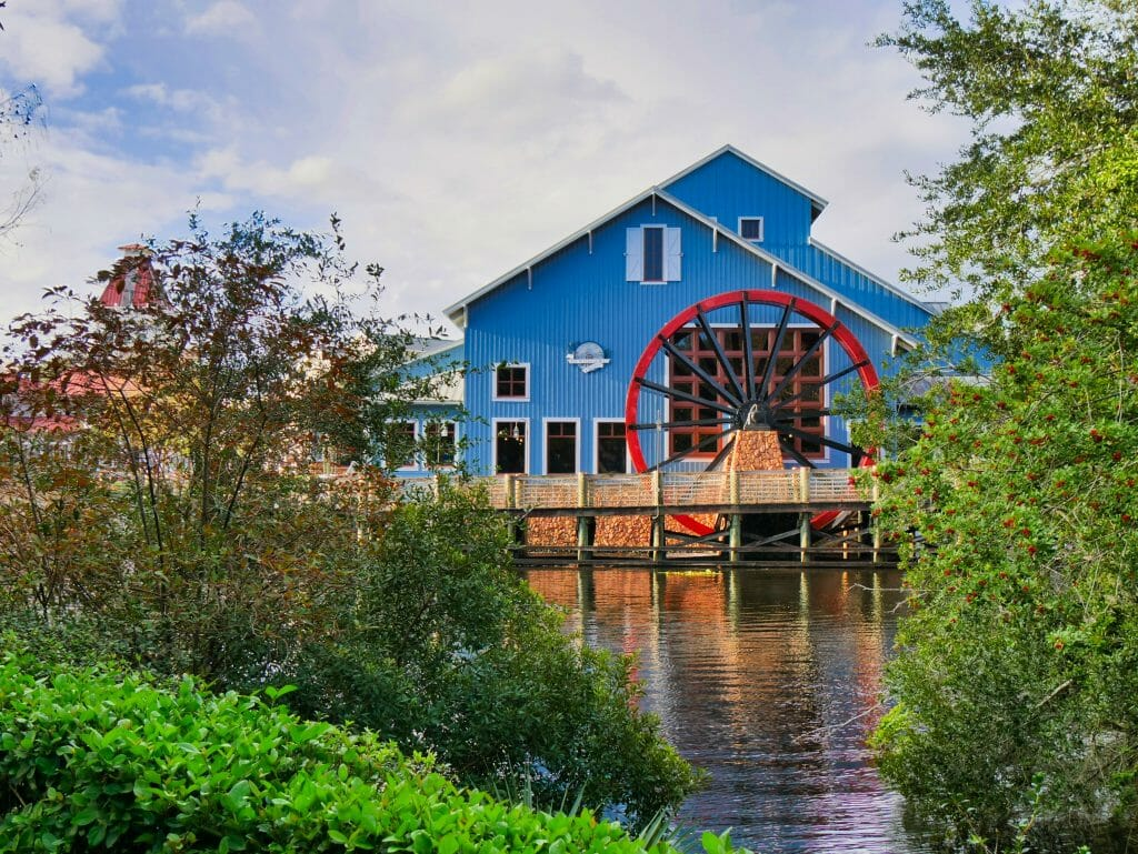 A blue building with a red water wheel