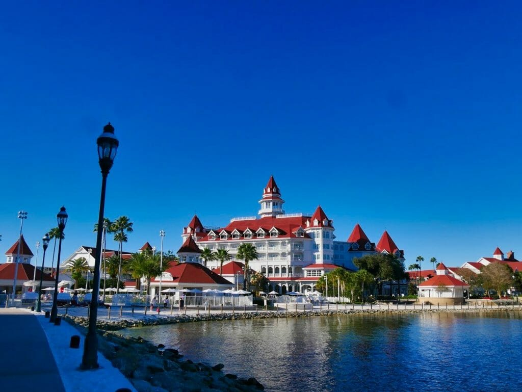 The Grand Floridian resort with water in front and blue sky