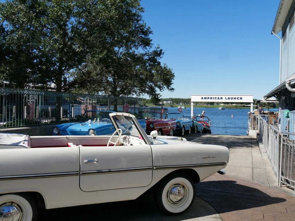Amphicar Launch at Disney Springs with old school looking car boats lined up in front of the water
