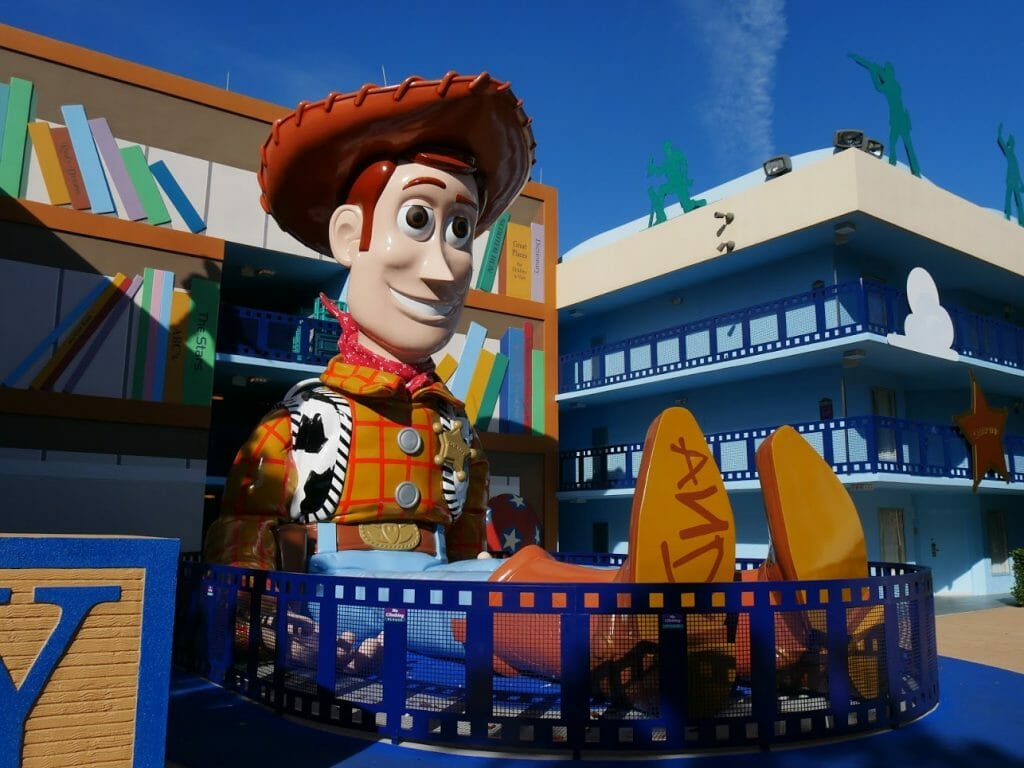 A giant Woody sitting down at Disney World All Star Movies resort Orlando