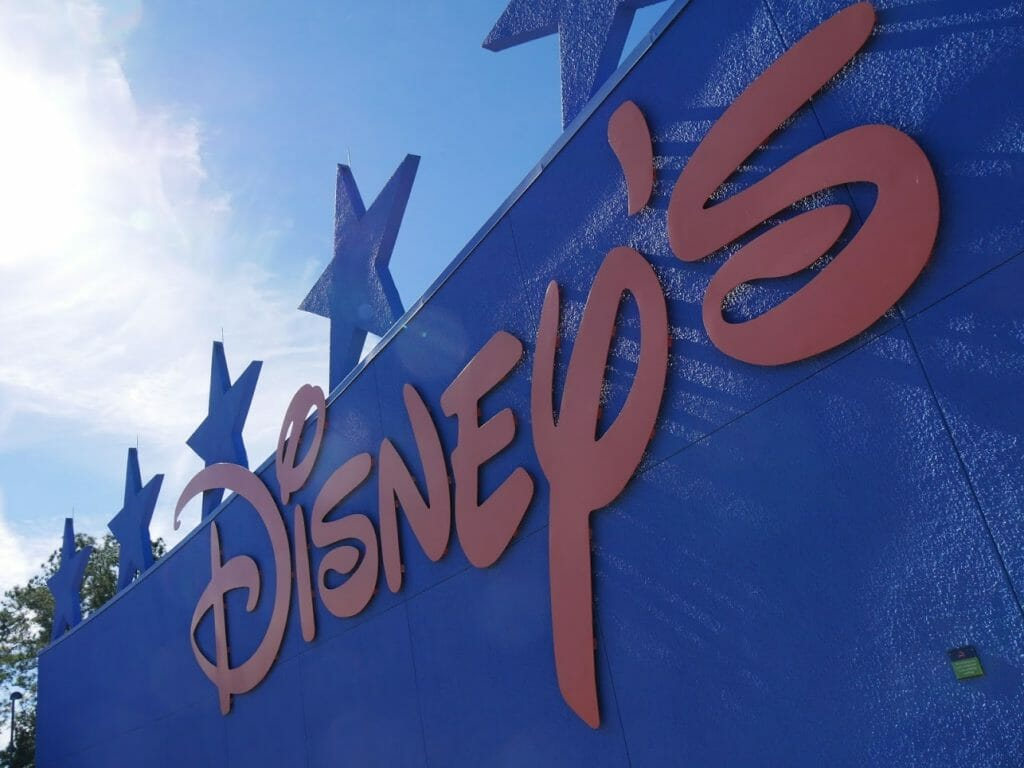 "A big ""Disney's"" sign at All Star Movies resort Disney World Orlando Florida"