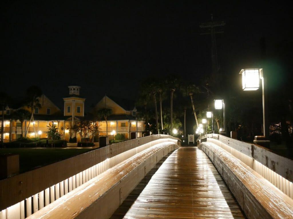 A bridge lit up at night at Disney's Caribbean Beach resort
