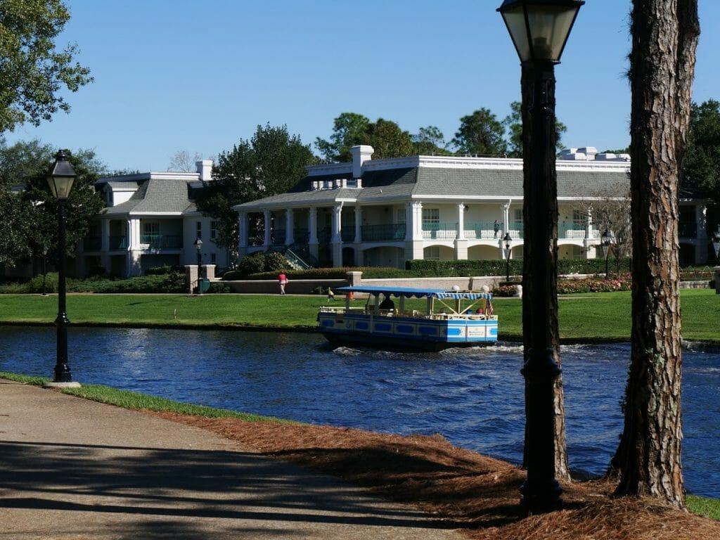 A Disney Springs boat on a river outside Port Orleans Riverside resort Disney