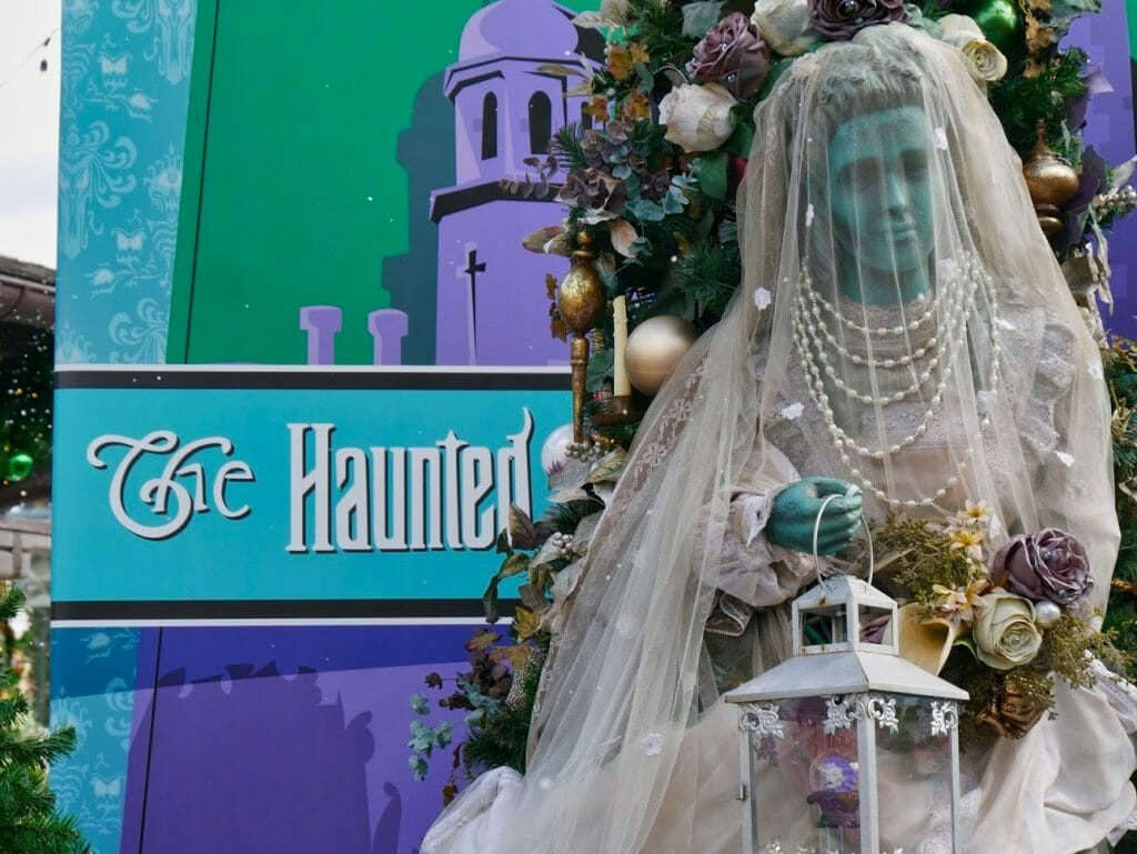 Haunted Mansion Christmas tree with a ghost bride protruding from the tree