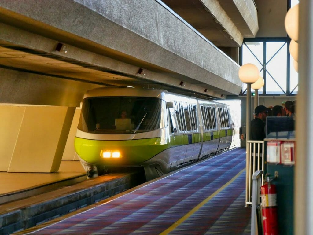 A Monorail train arriving at the Contemporary resort