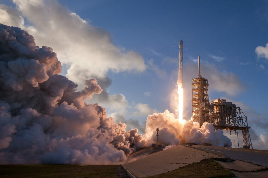 rocket blasting off at kennedy space center