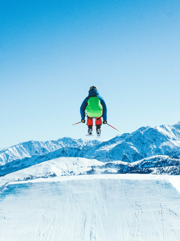 man skiing from behind