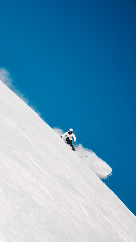 woman skiing on a steep slope