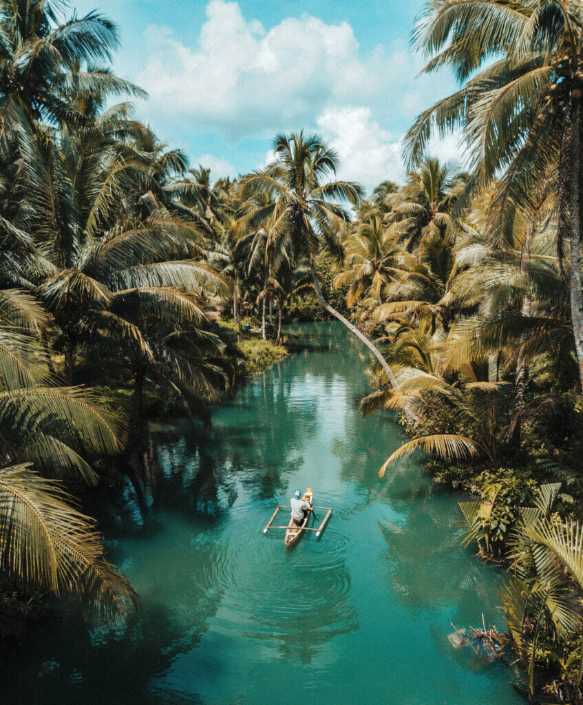 man on a canoe in the jungle